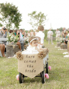 Baby Flower Girl Being Pulled In Wagon