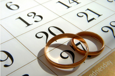 two rings sitting on a calendar