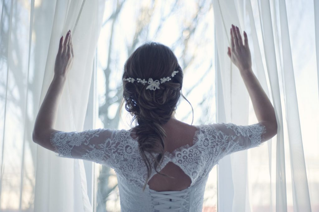 Morning Wedding - Bride Looking Out Window