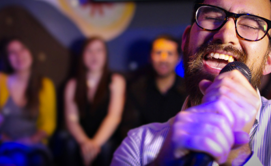Man With Glasses Singing Karaoke - Planning A Class Reunion