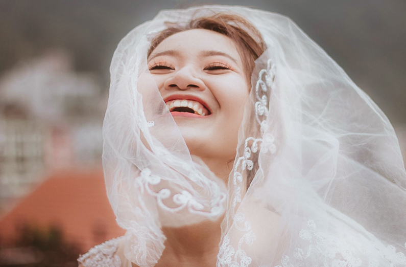 Wedding Makeup - Smiling Bride Wearing Veil