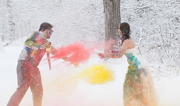 Wedding Dress Traditions - Trash The Dress - Bride And Groom Throwing Colored Powder In The Snow